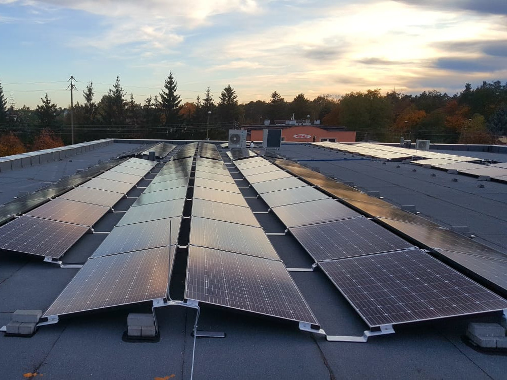 49 kWp east-west installation mounted on the flat roof of the service building in Otwock.